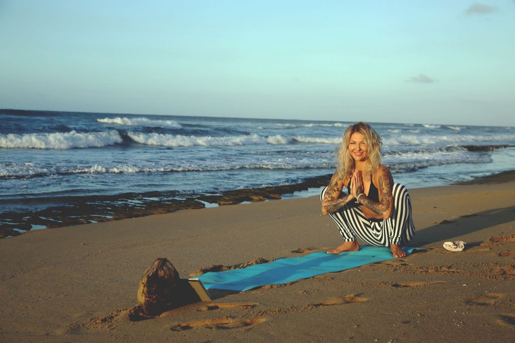 yoga on the beach in the fall